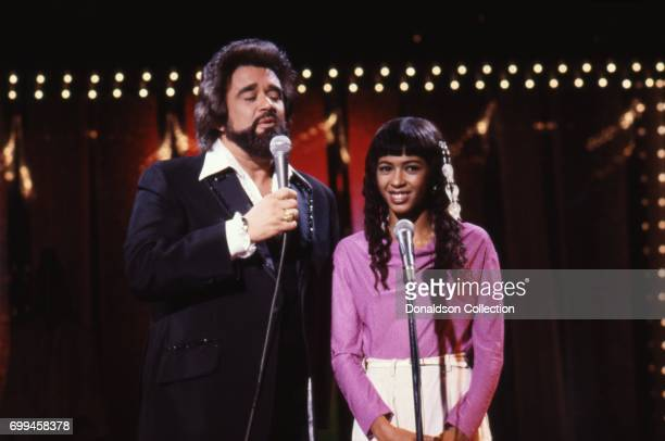 Host Wolfman Jack and singer Irene Cara in a still from the TV show 'Midnight Special' in September 1980 in Los Angeles California