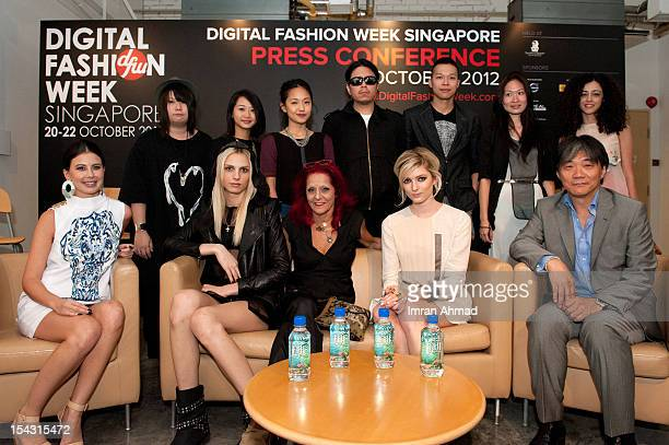 Host Yvette King Andrj Pejic Patricia Field Guo Pei and young designers attend the inaugural Digital Fashion Week press conference on October 17 2012...