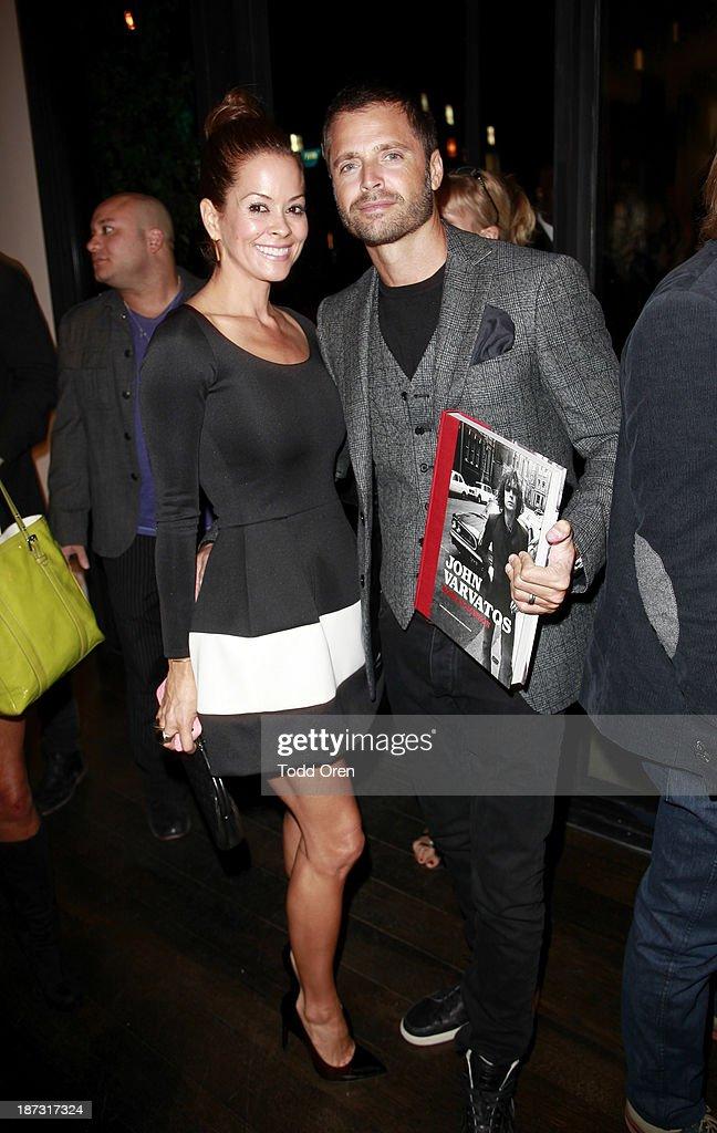 Host/actress Brooke Burke-Charvet (L) and actor David Charvet arrive at the 'John Varvatos: Rock In Fashion book launch celebration held at John Varvatos Los Angeles on November 7, 2013 in Los Angeles, California.