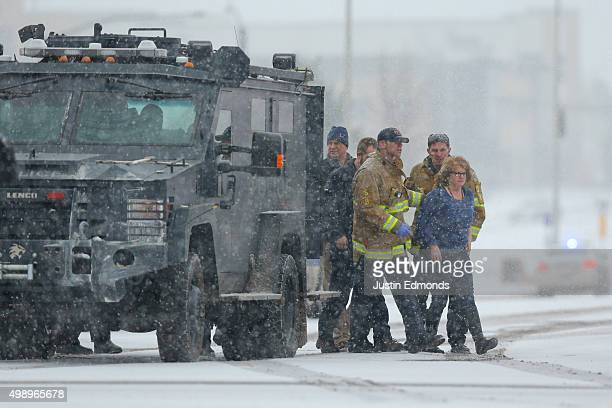 Hostages are escorted by police during an active shooter situation outside a Planned Parenthood facility where an active shooter reportedly injured...