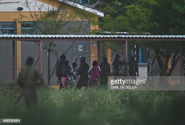 Hostages are escorted out of Garissa University after Kenya Defence Forces ended a siege by gunmen in the campus on April 2 2015 in the northeastern...