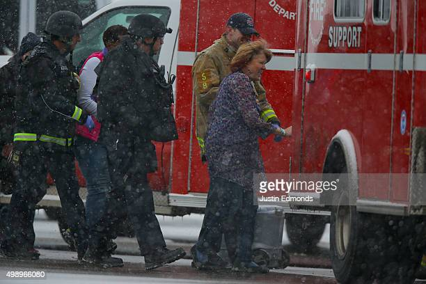 Hostages are escorted to an ambulance during an active shooter situation outside a Planned Parenthood facility where an active shooter reportedly...