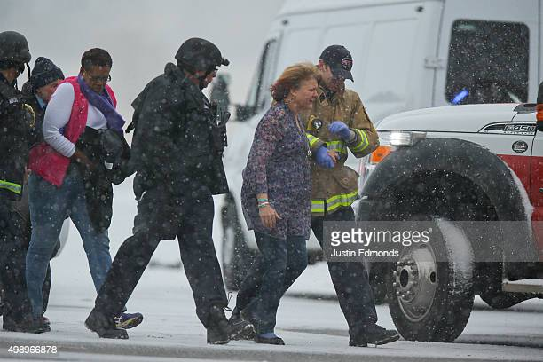 Hostages are escorted to safety during an active shooter situation outside a Planned Parenthood facility where an active shooter reportedly injured...