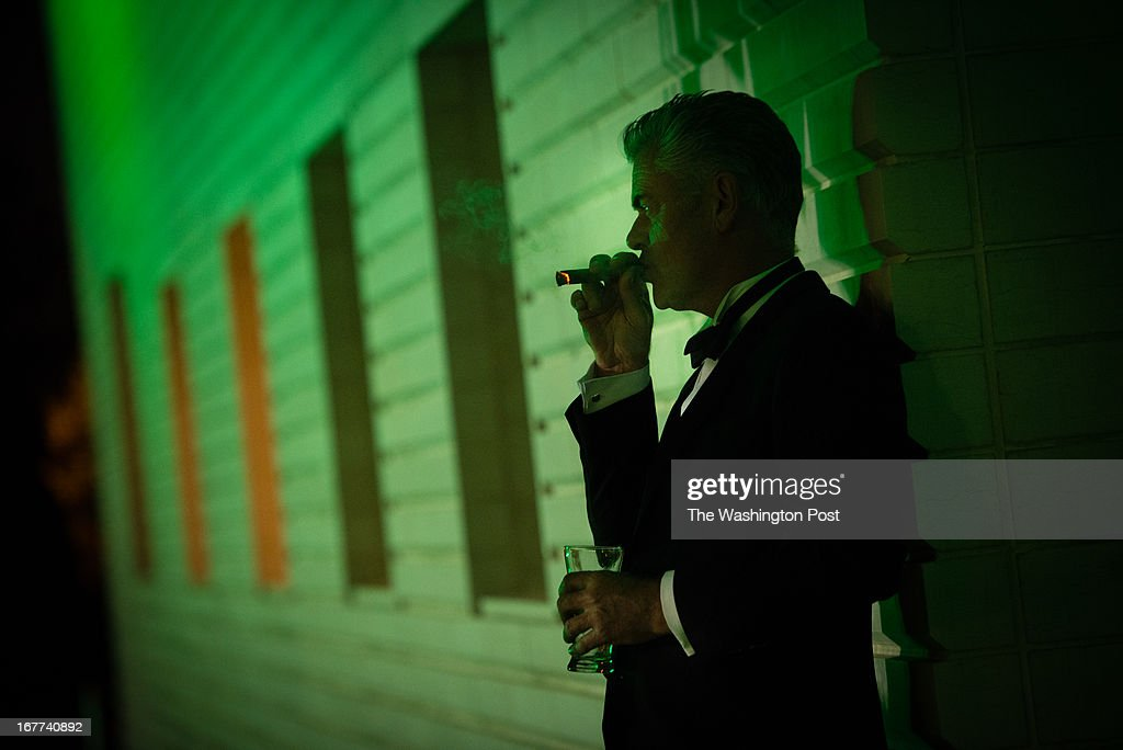 MSNBC hosted this after party following the White House Correspondents Dinner. Steve Thomson, assistant to actor, Ian McKellen, enjoys a cigar and drink at the event.