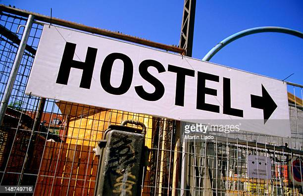 Hostel sign on fence.