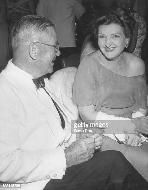 Hostess And Guest Exchange Party Talk Mrs William F Hayden and John Mead visit in the Cherry Hills club lounge at a cocktail party she hosted...