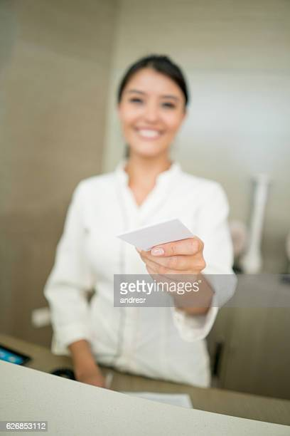 Hostess at a hotel handling a card key