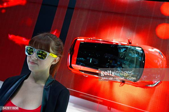 Hostess at the Opel Vauxhall Corsa stand World's largest automobile exposition the 2014 Paris Motor Show Mondial de l'Automobile gets under way with...