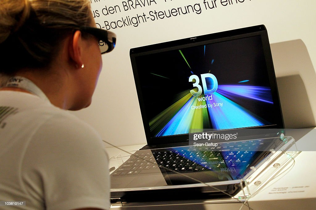 A hostess, at the request of the photographer, looks through 3D glasses at the prototype of a Sony 3D laptop computer at the Sony stand at the 2010 IFA technology and consumer electronics trade fair at Messe Berlin on September 3, 2010 in Berlin, Germany. The 2010 IFA will be open to the public from September 3-8.