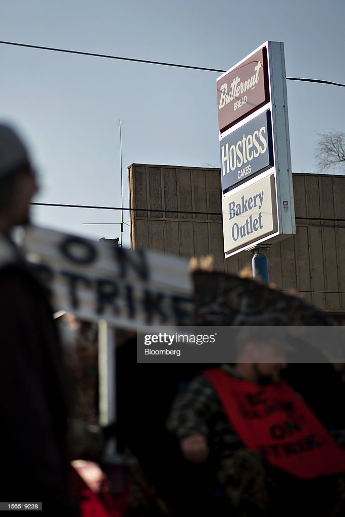 Hostess Brands Inc. signage is displayed as striking workers picket outside one of the company's bakeries in Peoria, Illinois, U.S., on Friday, Nov. 16, 2012. Hostess Brands Inc., the bankrupt maker of Wonder bread and Twinkies, said it will fire more than 18,000 workers and liquidate after a nationwide strike by bakery workers crippled operations. Photographer: Daniel Acker/Bloomberg via Getty Images