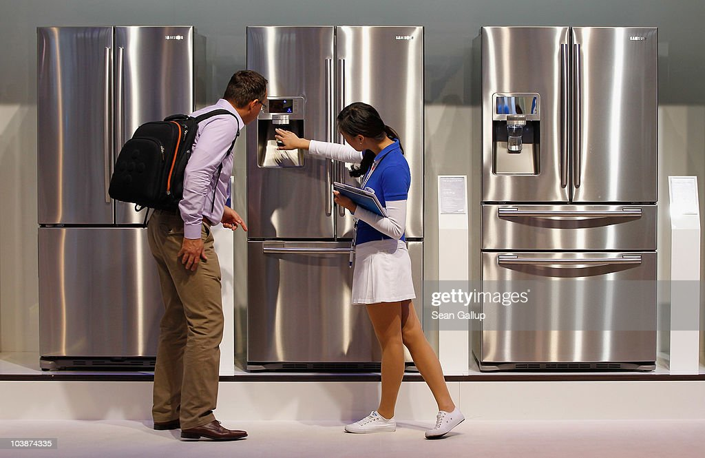 A hostess explains the functions of new energy-efficient refrigerators at the Samsung home appliances stand at the 2010 IFA technology trade fair at Messe Berlin on September 7, 2010 in Berlin, Germany. The IFA 2010 is open to the public from September 3-8.