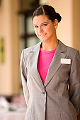 A hostess in grey jacket and pink blouse