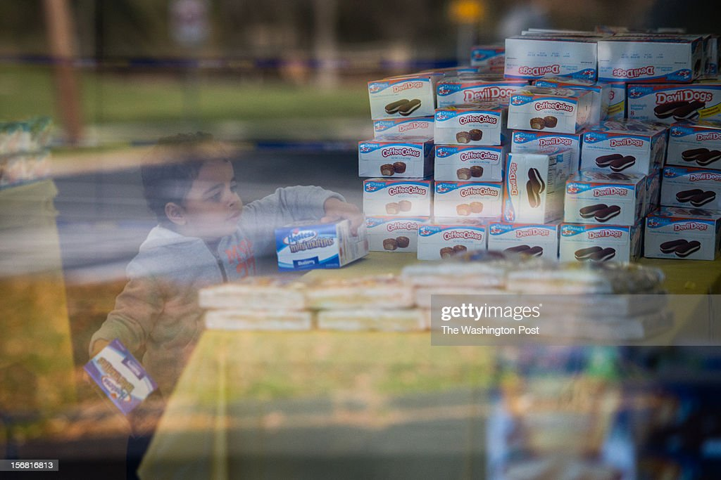 Hostess is proceeding with its legal plans to shut down and were in bankruptcy court on Wednesday. At The Hostess Bakery Thriftshop on Taft Street in Rockville, MD, some customers came to stock up, others were just making their usual trip to the store. Adrian Taylor, 2, of Germantown picks up several boxes of treats in the store. He came with his father. Taylor will be 3 on Dec 30.