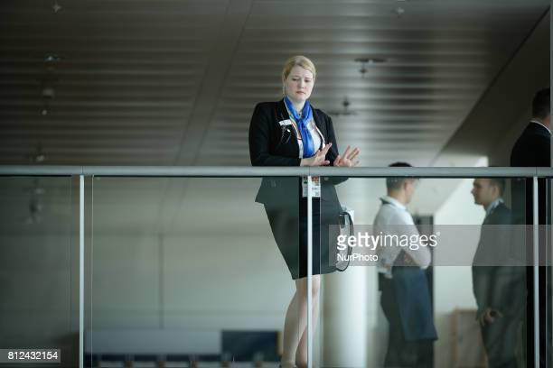 A hostess is seen waiting near the plenary hall where the G20 leaders and permanent guests will meet on 8 July 2017 during the G20 summit in Hamburg...