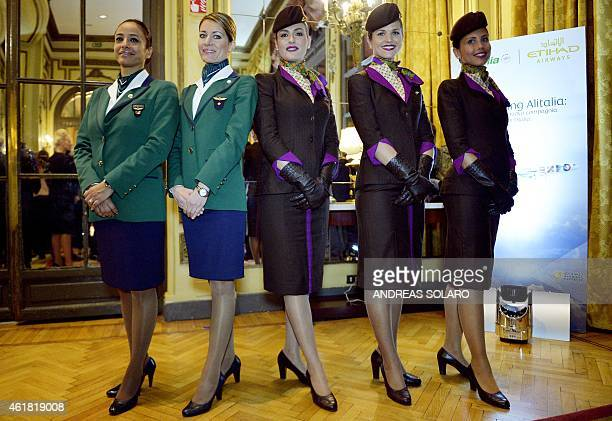 Hostess of Alitalia and Etihad airlines pose for photographers on the sideline of a press conference to promote the new Alitalia services on January...