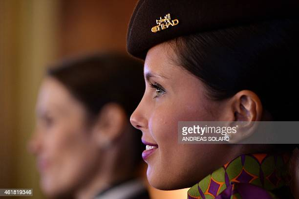 Hostess of the Alitalia and Etihad airlines pose for photographers on the sideline of a press conference to promote the new Alitalia services on...