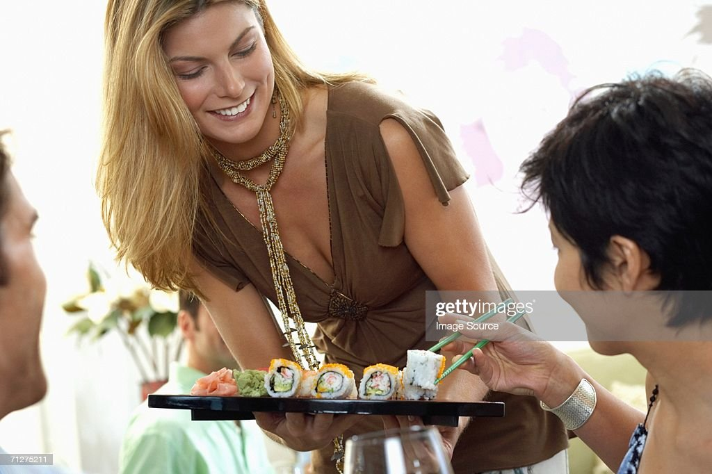 Hostess offering canapes