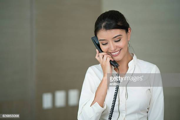 Hostess on the phone at the hotel