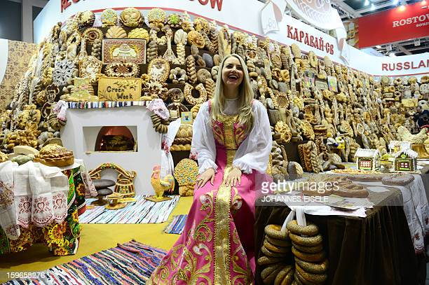 A hostess poses at a Russian backery and pastry booth during the opening of the Gruene Woche Agricultural Fair in Berlin on January 18 2013 This year...