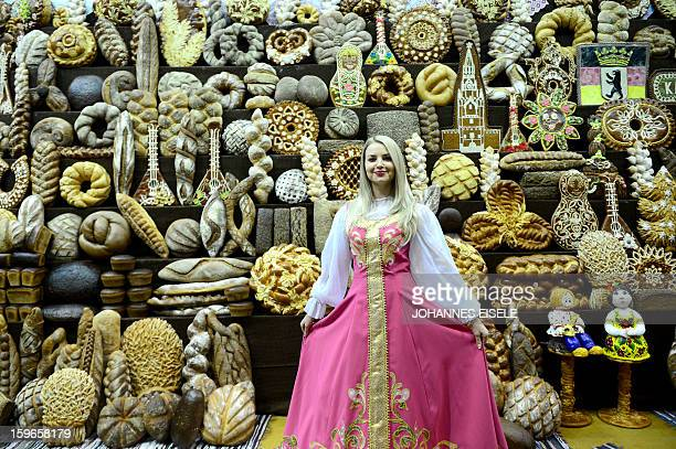 A hostess poses at a Russian backery booth during the opening of the Gruene Woche Agricultural Fair in Berlin on January 18 2013 This year the...