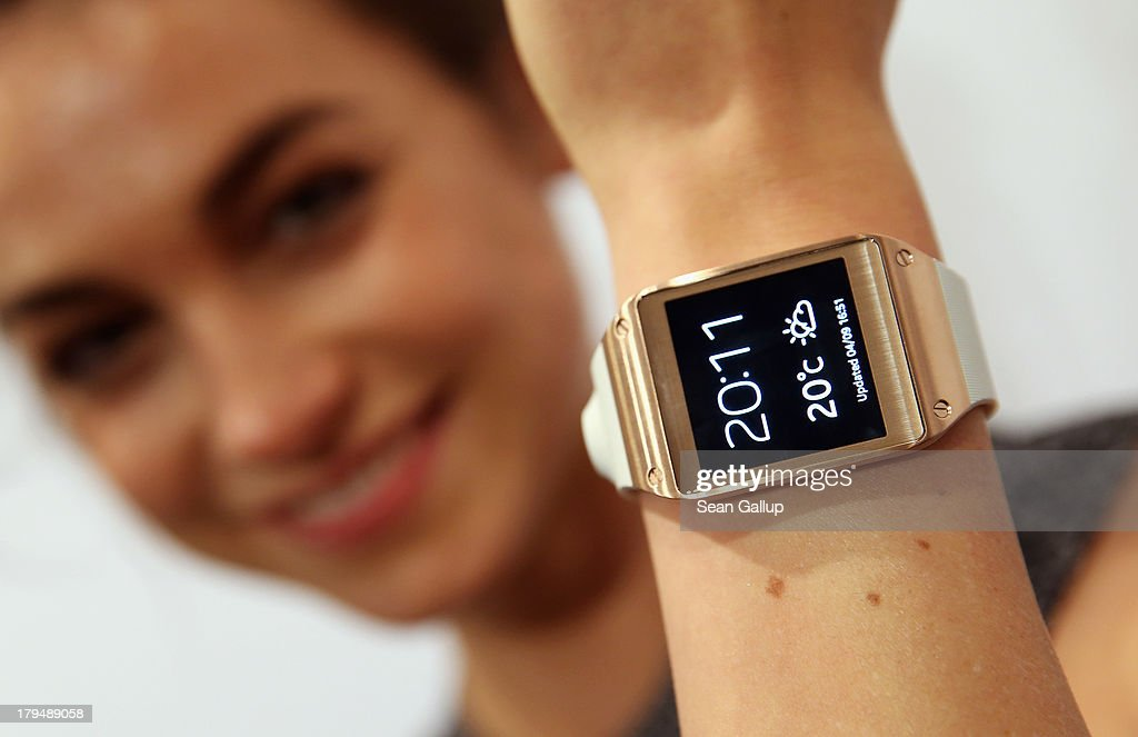 A hostess presents the new Samsung Galaxy Gear smart watch at the Samsung Unpacked 2013 Episode 2 at Tempodrom on September 4 2013 in Berlin Germany...