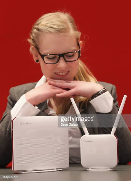 A hostess presents the new Vodafone LTE highspeed router and modem at the Vodafone stand at the CeBIT technology trade fair on February 28 2011 in...
