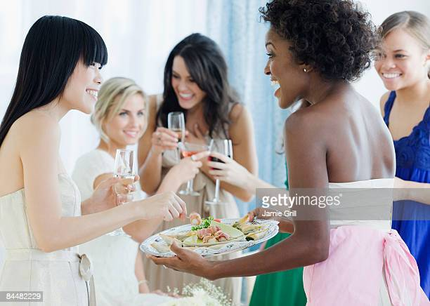 Hostess serving appetizers to her Guests