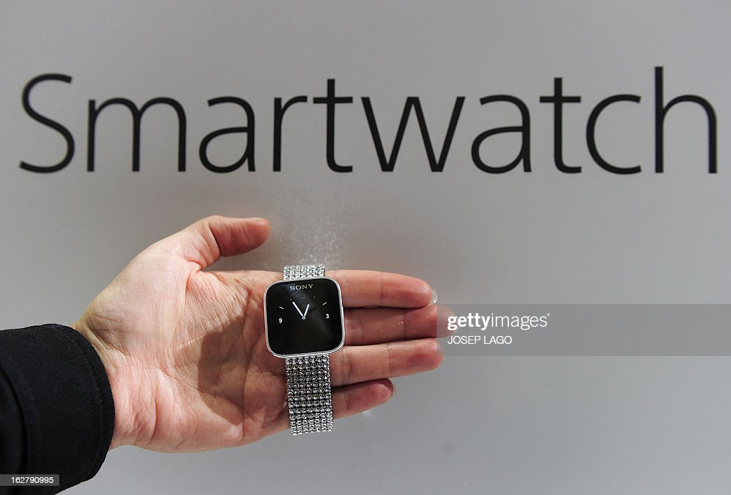 A hostess shows a Smartwatch by Sony on February 27, 2013 at the Mobile World Congress, the world's biggest mobile fair, in Barcelona. The European Union warned member states on February 26 to free up the airwaves for new, super-fast fourth generation mobile networks and threatened legal action against those that deliberately block the process.