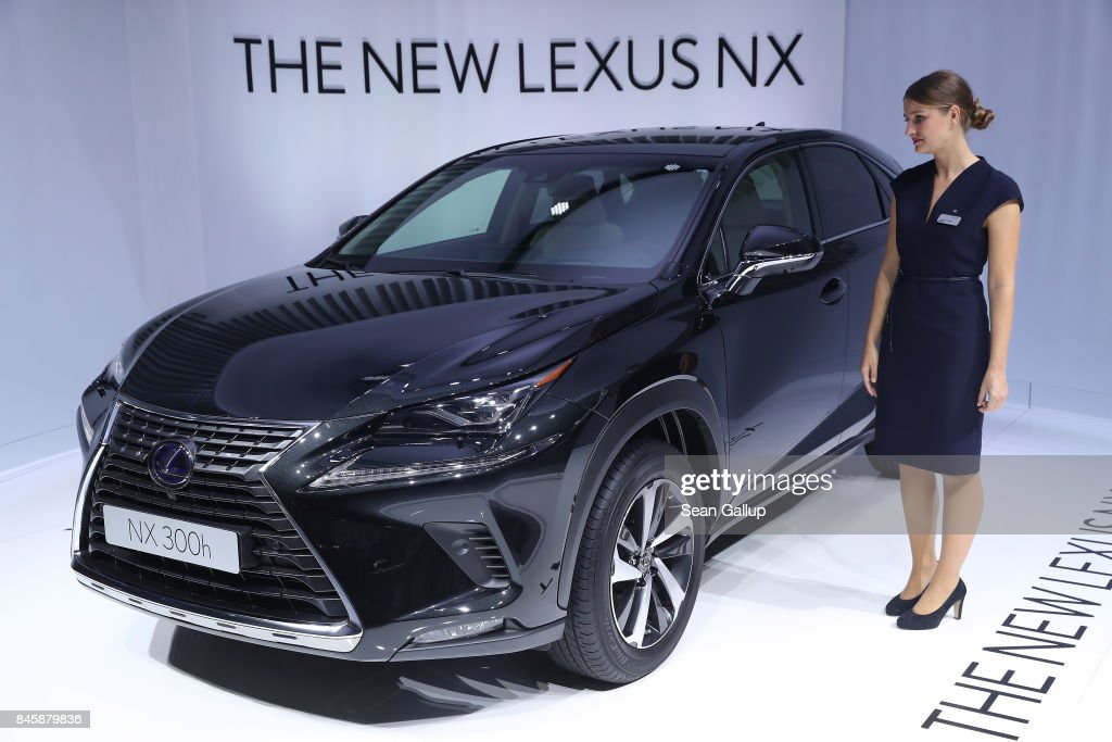 A hostess stands next to the new Lexus NX 300h hybrid crossover at the 2017 Frankfurt Auto Show on September 12, 2017 in Frankfurt am Main, Germany. The Frankfurt Auto Show is taking place during a turbulent period for the auto industry. Leading companies have been rocked by the self-inflicted diesel emissions scandal. At the same time the industry is on the verge of a new era as automakers commit themselves more and more to a future that will one day be dominated by electric cars.