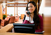 Hostess talking on phone in restaurant