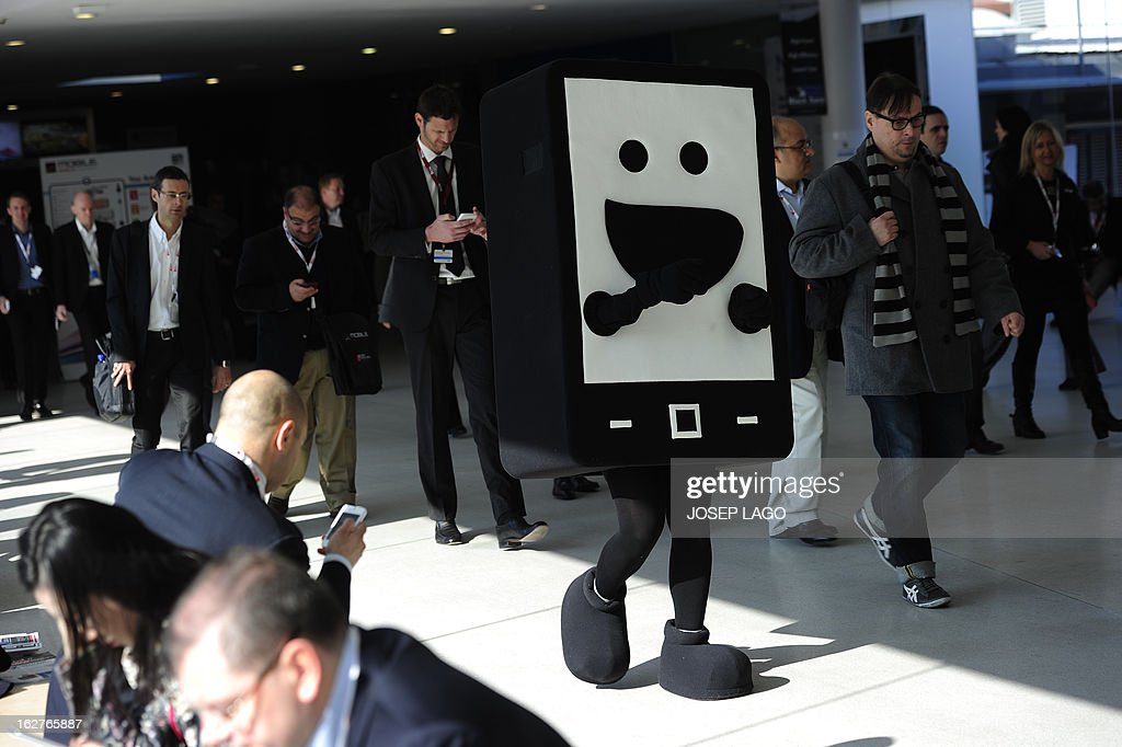 A hostess wearing a mobile phone costume walks at the 2013 Mobile World Congress in Barcelona on February 26, 2013. The 2013 Mobile World Congress, the world's biggest mobile fair, is held from February 25 to 28 in Barcelona. AFP PHOTO / JOSEP LAGO