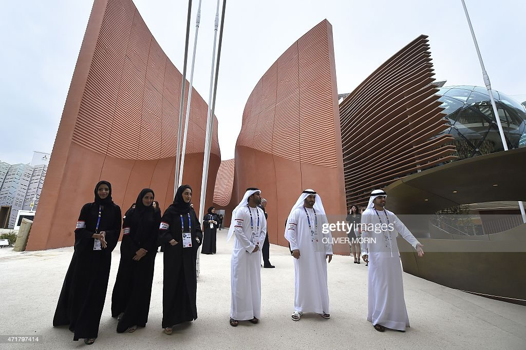 Hostesses and stewards welcome visitors at the pavilion of United Arab Emirates on the opening day of the Universal Exposition Expo Milano 2015 May 1...