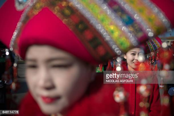 TOPSHOT Hostesses are seen on Tiananmen Square during the opening of the National People's Congress in Beijing on March 5 2017 China's rubberstamp...