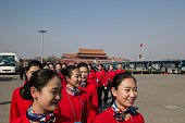 Hostesses arrive for the closing session of the Chinese People's Political Consultative Conference at the Great Hall of the People in Beijing on...