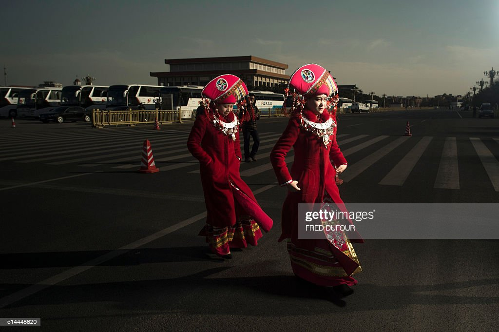 TOPSHOT Hostesses from Guangxi province walks at the 2nd plenary session of the National People's Congress outside the Great Hall of the People in...