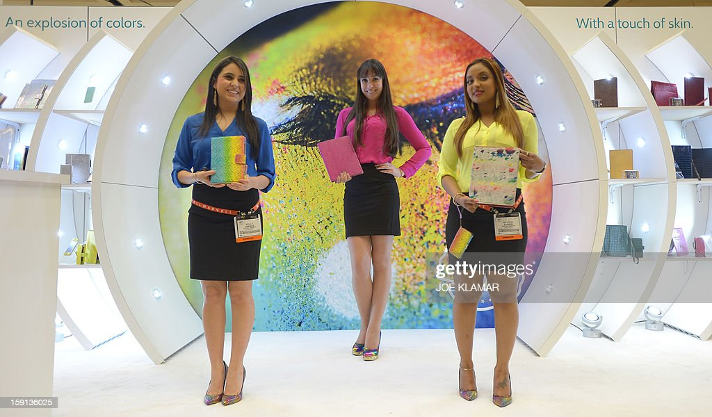 Hostesses of Appeal Brazil offer iPad cases at the 2013 International CES at the Las Vegas Convention Center on January 8, 2013 in Las Vegas, Nevada. CES, the world's largest annual consumer technology trade show, runs from January 8-11 and is expected to feature 3,100 exhibitors showing off their latest products and services to about 150,000 attendees.AFP PHOTO / JOE KLAMAR