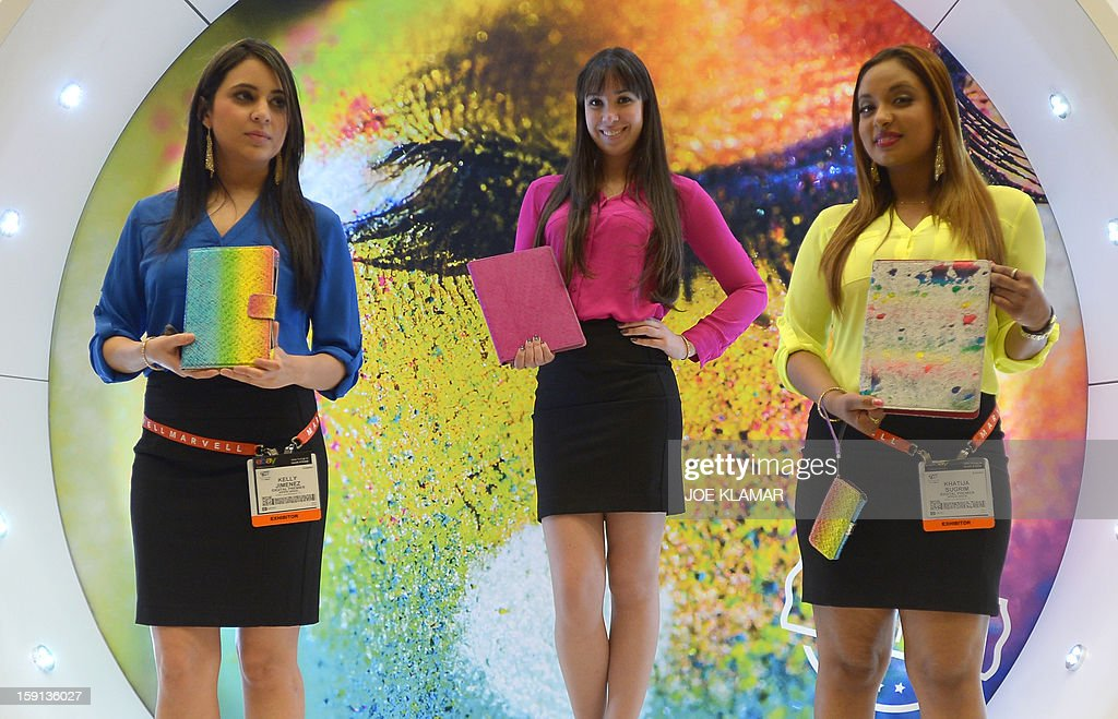 Hostesses of Appeal Brazil offer iPad cases at the 2013 International CES at the Las Vegas Convention Center on January 8, 2013 in Las Vegas, Nevada. CES, the world's largest annual consumer technology trade show, runs from January 8-11 and is expected to feature 3,100 exhibitors showing off their latest products and services to about 150,000 attendees.