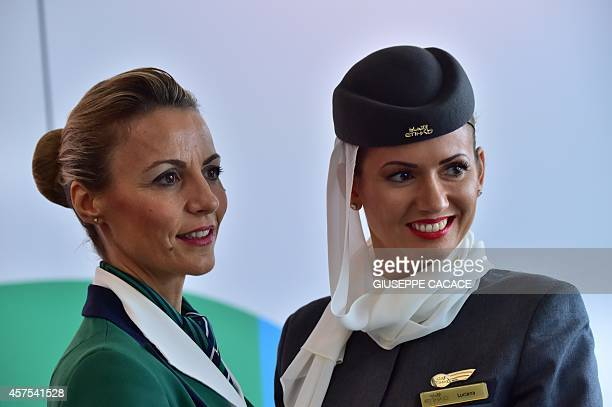 Hostesses of Italian company Alitalia and Etihad Airways are pictured during a press conference to announce the partnership beetwen Alitalia Etihad...