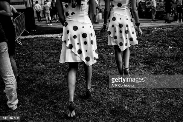 Hostesses of the polka dot jersey of best climber are pictured near the finish line during the 1875 km eighth stage of the 104th edition of the Tour...