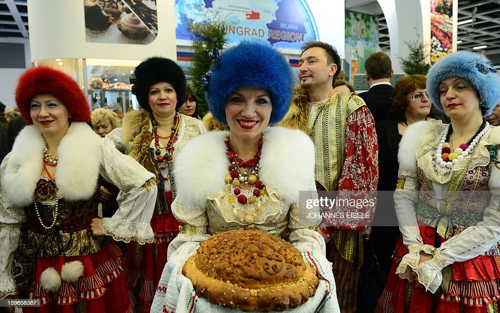 Hostesses pose with traditional bread at a Russian booth during the opening of the Gruene Woche Agricultural Fair in Berlin on January 18, 2013. This year the official partner country of the fair is The Netherlands. EISELE