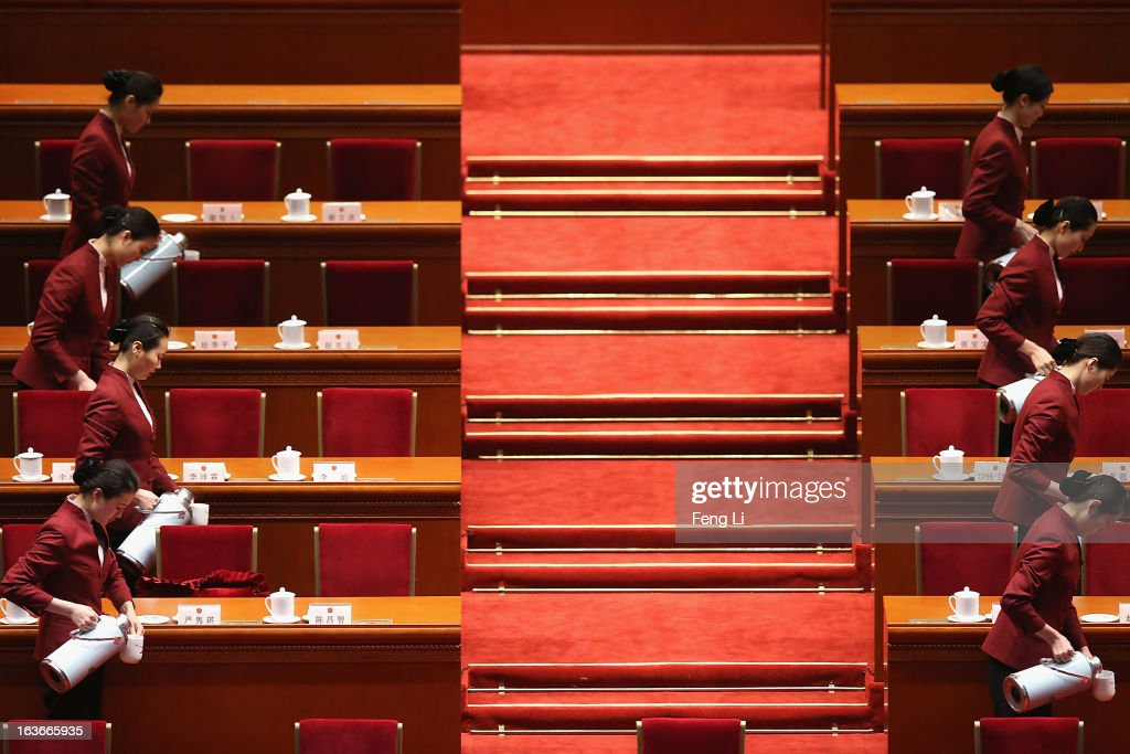 Hostesses serve tea before the fourth plenary meeting of the National People's Congress at the Great Hall of the People on March 14, 2013 in Beijing, China. Xi Jinping, general secretary of the Communist Party of China Central Committee, was elected President of the People's Republic of China and Chairman of the Central Military Commission on Thursday.