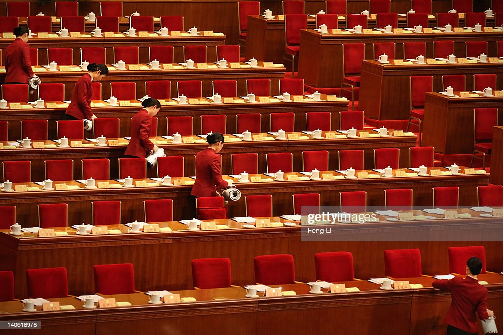 Hostesses serve tea to delegates before the opening ceremony of the Chinese People's Political Consultative Conference at the Great Hall of the People on March 3, 2012 in Beijing, China. The Chinese People's Political Consultative Conference opens on March 3 in Beijing.