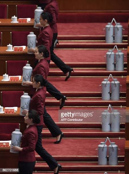 Hostesses serves tea before the opening session of the Chinese Communist Party's Congress at the Great Hall of the People in Beijing on October 18...
