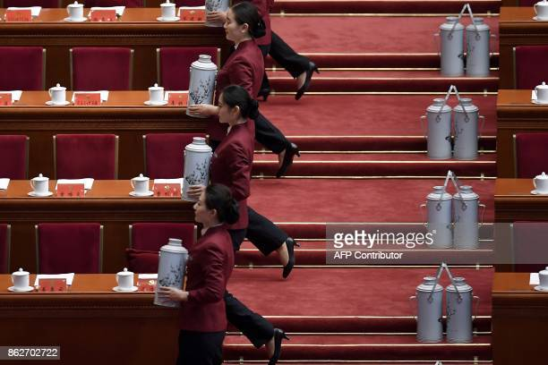 TOPSHOT Hostesses serves tea before the opening session of the Chinese Communist Party's Congress at the Great Hall of the People in Beijing on...