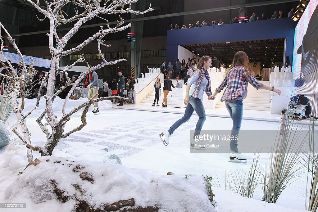 Hostesses skate on an ice rink next to artificial snow at the Hilfiger Denim stand at the 2012 Winter Bread And Butter fashion trade fair at former Tempelhof Airport on January 18, 2012 in Berlin, Germany. Bread And Butter is a semi-annual event and is among Europe's major fashion trade fairs.