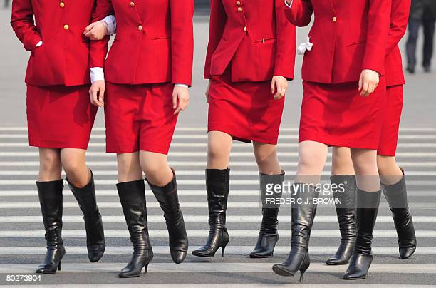 Hostesses walk on Tiananmen Square as delegates attend a session of the National People's Congress China's annual rubberstamp parliament on March 17...