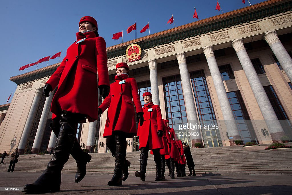 Hostesses walk outside the Great Hall of the People following the last day of the Chinese People's Political Consultative Conference (CPPCC) during the National People's Congress (NPC) in Beijing on March 13, 2012. The 2012 NPC session is the last before a handover of power that begins later this year, and leaders are anxious to ensure the world's second-largest economy grows at a steady pace while keeping a lid on social unrest. AFP PHOTO / Ed Jones