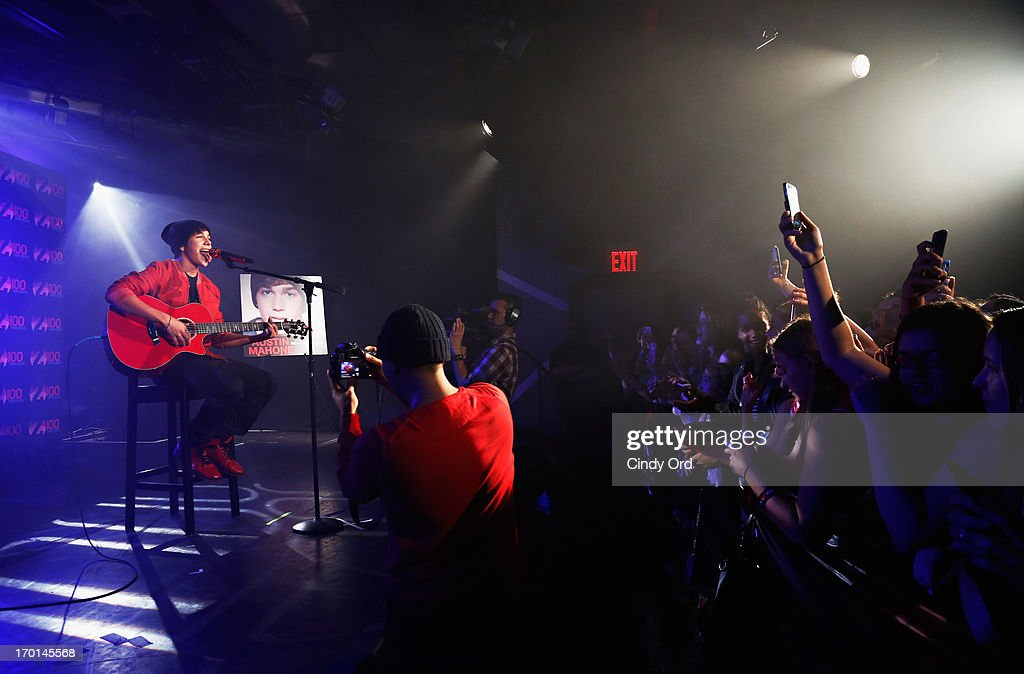 Z100 hosts a live chat and performance with singer <a gi-track='captionPersonalityLinkClicked' href=/galleries/search?phrase=Austin+Mahone&family=editorial&specificpeople=9429678 ng-click='$event.stopPropagation()'>Austin Mahone</a> (L) to celebrate the world premiere of his new single, 'What About Love,' at the iHeartRadio Theater presented by P.C. Richard & Son on June 7, 2013 in New York City.