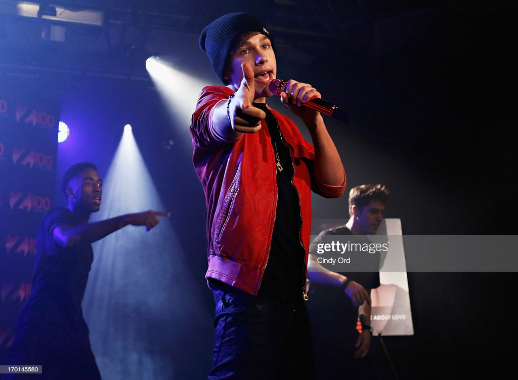 Z100 hosts a live chat and performance with singer <a gi-track='captionPersonalityLinkClicked' href=/galleries/search?phrase=Austin+Mahone&family=editorial&specificpeople=9429678 ng-click='$event.stopPropagation()'>Austin Mahone</a> (C) to celebrate the world premiere of his new single, 'What About Love,' at the iHeartRadio Theater presented by P.C. Richard & Son on June 7, 2013 in New York City.