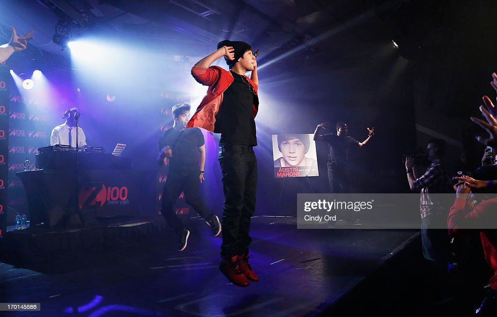 Z100 hosts a live chat and performance with singer Austin Mahone (C) to celebrate the world premiere of his new single, 'What About Love,' at the iHeartRadio Theater presented by P.C. Richard & Son on June 7, 2013 in New York City.